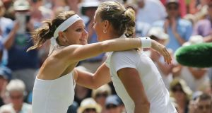 Petra Kvitova of the Czech Republic (right) hugs compatriot Lucie Safarova whom she defeated in their semi final match at Wimbledon. Photograph: Tatyana Zenkovich