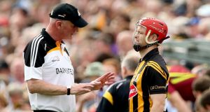 Kilkenny  manager Brian Cody speaks to Tommy Walsh before introducing him  as a second-half substitute during the Leinster GAA Hurling Senior Championship semi-final against Galway.  Photograph: James Crombie/Inpho