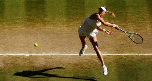 Canada's Eugenie Bouchard in action during her semi-final win over Simona Halep. Photograph: Clive Brunskill/Getty Images