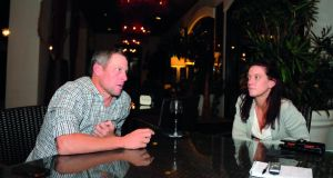 Disgraced cycling champion Lance Armstong talks with Emma O'Reilly in Orlando, USA.