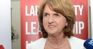 Minister for Social Protection Joan Burton:  has pledged to establish an independent commission on low pay  to advise the Government on minimum wage levels  if elected Labour leader. Photograph: Eric Luke/The Irish Times