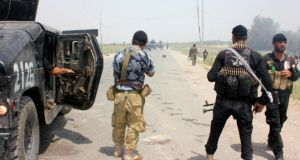 Iraqi security forces and armed volunteers move with military vehicles during clashes with militants of Islamic State in Iraq and Syria (Isis), also known as the Islamic State in Iraq and the Levant, in the town of Dalli Abbas in Diyala province. Photograph: Reuters.