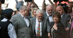 Flanked by body guards Australian-born entertainer Rolf Harris (C) arrives for sentencing at Southwark Crown Court in London today. Photograph: Will Oliver/EPA.