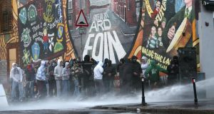 Flashpoint: watercannon being used on rioters in Ardoyne. Photograph: Dara Mac Dónaill