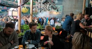 Tradgarden, an open-air summertime club where you can sip beers on wooden risers, play ping-pong and dance til dawn. Photograph: Rob Schoenbaum/New York Times