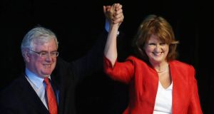 New Labour Party leader  Joan Burton is congratulated by former leader Eamon Gilmore at the Mansion House in Dublin. Photograph: PA