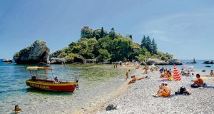 Isola Bella island, in Taormina, Sicliy. Photograph: Getty