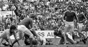 A scramble near the Kerry goalmouth as   Cork's Denis Allen gains control of the ball in front of a powerless Jimmy Deenihan in the '1976 Munster football final.