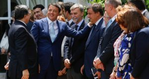 Italian prime minister Matteo Renzi (centre) with European Commission president José Manuel Barroso (left) and members of the EU commission following a meeting in Rome yesterday. Photograph: Remo Casilli/Reuters