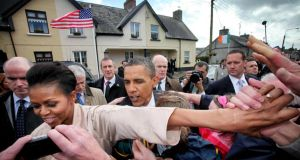 First lady Michelle Obama leads the way for her husband US president Barack Obama in Moneygall, Co Offaly, in May 2011. Photograph: Bryan O'Brien