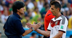 Good job . . . Germany's Miroslav Klose is congratulated by coach Joachim Löw after their victory over France at the Maracanã in Rio de Janeiro. Photograph: Kai Pfaffenbach/Reuters
