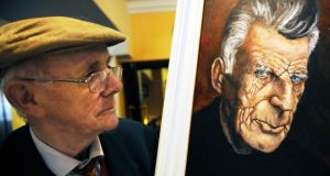Joe O'Connell looking at a painting of Samuel Beckett at the Hay Festival Kells, Co Meath, which has returned for a second year. Photograph: Clodagh Kilcoyne