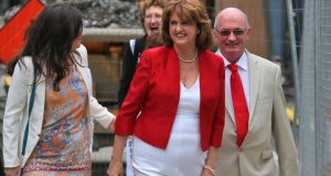 Joan Burton with  her daughter Aoife and husband  Pat at the Mansion House yesterday. Photograph: Collins