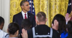 US president Barack Obama presides over a naturalisation ceremony for active duty service members and civilians in the East Room of the White House yesterday. Photograph:  Getty Images