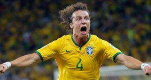 David Luiz  celebrates after scoring his side's second goal from a free-kick against Colombia during the World Cup quarter-final at the Arena Castelao in Fortaleza. Photograph: Sergey Dolzhenko/EPA