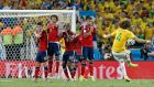 Brazil's David Luiz scores his side's second goal from a free-kick against Colombia during the World Cup quarter-final at the Arena Castelao in Fortaleza. Photograph:  Tolga Bozoglu/EPA