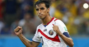 Bryan Ruiz of Costa Rica celebrates after scoring during the penalty shootout against Greece. Photograph: EPA
