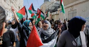 Palestinian women hold flags as they chant slogans during the funeral of 16-year-old Mohammed Abu Khudair in Shuafat, an Arab suburb of Jerusalem. Photograph: Ammar Awad /Reuters