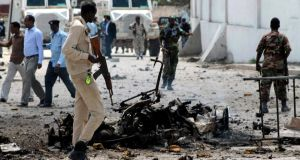 Security officers gather at the scene of a car bomb explosion in front of the country's parliament in Mogadishu, Somalia. Photograph: Said Yusuf Warsame/EPA