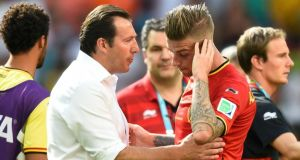 Belgium's coach Marc Wilmots consoles  Toby Alderweireld  after defeat to Argentina in Brasilia.  Photograph: Dylan Martinez / Reuters