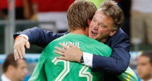 Netherlands coach Louis van Gaal congratulates goalkeeper Tim Krul after a penalty shootout in the 2014 World Cup quarter-finals against Costa Rica   at the Fonte Nova Arena in Salvador. Photograph: Sergio Moraes / Reuters