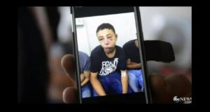 A still from a video clip showing Tariq Khdeir's face with a heavy black eye and swollen lip. He is a cousin of Mohammed Abu-Khdeir, the youth whom Palestinians believe was abducted and murdered by far-right Israelis on Wednesday.