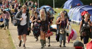 """I arrived back in Ireland after five days and nights at Glastonbury, a unique and colossal festival where nearly 200,000 people on site generally get along and are polite, friendly, and manage to have a great time without falling into the dopey traps so common at Irish outdoor shows."" Above, festivalgoers leaving the Glastonbury festival in Somerset. Photograph: Yui Mok/PA"