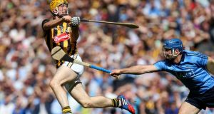 Kilkenny's Colin Fennelly gets his shot away as Dublin's  Stephen Hiney moves in during the Leinster SHC Final at Croke Park. Photograph: Ryan Byrne/Inpho