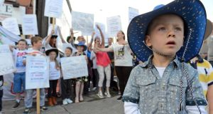 Alex Harris (3) from  Ballybough, with local residents protesting against the cancellation of any of the Garth Brooks Croke Park concerts at Ballybough in Dublin today. Photograph: Eric Luke / The Irish Times