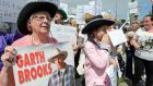 Marie Gorman (left) from Ballybough, along with local residents protesting against the cancellation of any of the Garth Brooks Croke Park concerts.  Photograph: Eric Luke / The Irish Times
