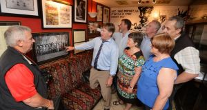 Bobby Campion (centre) with Jack Moyney's extended family at the official opening of a first World War museum at Bob's Bar in Durrow, Co Laois. Photograph: Alan Betson