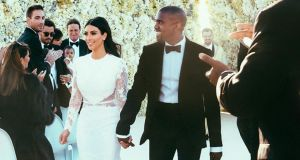 Kim Kardashian and Kanye West at their wedding in Florence, Italy, in May. The owner of a Co Limerick castle where the couple honeymooned has denied claims they did not pay their bill. Photograph: E! News/PA Wire.