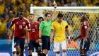 Brazil captain Thiago Silva  of Brazil is booked by Spanish referee Carlos Velasco Carballo during the World Cup 2014 quarter-final against  Colombia.  Photograpgh: Georgi Licovski/EPA