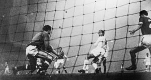 Argentinian born Real Madrid centre forward Alfredo Di Stefano back heels the ball past the Manchester United goalkeeper, Harry Gregg, at Old Trafford in 1959. Photograph:Keystone/Getty Images