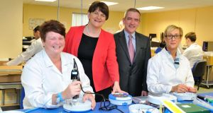 Pictured with Enterprise, Trade and Investment Minister Arlene Foster is Declan O'Mahoney, chief executive of HeartSine Technologies and (left) Shauna Heggarty and (right) Eileen Ervin. Picture: Michael Cooper