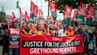 Greyhound workers and others march from Liberty Hall to  Dublin  City Hall in protest at pay cuts yesterday. Photograph: Collins