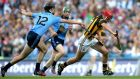 Dublin's Danny Sutcliffe tries to tackle Kilkenny's Cillian Buckley in the Leinster hurling final. Photograph: Inpho