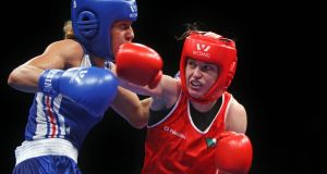 Ireland's Katie Taylor (red) on her way to defeating Estelle Mossely of France to win the 2014 European Elite Women's Championships 60kg final at the Polyvalent Arena, Bucharest, last month. photograph: Octavian Cocolos/Inpho