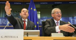 Italian Socialist vice-president of the Parliament Gianni Pittella (left) and European Peoples' Party group candidate designate for the presidency of the European Commission, Jean-Claude Juncker at the start of a meeting with political group of the parliament in Brussels yesterday. Photograph: EPA/Julien Warnand