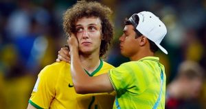 Brazil's David Luiz (left) is consoled by his captain  Thiago Silva after their 7-1 defeat to   Germany in their 2014 World Cup semi-final in Belo Horizonte. Photogrpah:  Eddie Keogh / Reuters