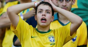A Brazil fan during their crushing defeat to  Germany   in Belo Horizonte. Photograph: Marcos Brindicci / Reuters