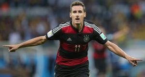 Miroslav Klose of Germany celebrates after becoming the highest ever goalscorer in World Cup history with the 16th of his career    at the Estadio Mineirao in Belo Horizonte. Photograph: Fernando Bizerra Jr. / EPA