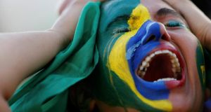 A Brazil fan reacts while watching a broadcast of the  World Cup semi-final against Germany at the Fan Fest in Brasilia. Photograph: Ueslei Marcelino/Reuters