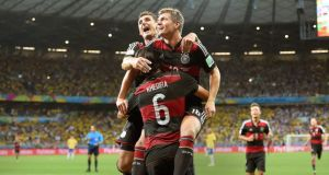 Germany's Toni Kroos  celebrates with Miroslav Klose  and Sami Khedira at the Estadio Mineirao in Belo Horizonte, Brazil.