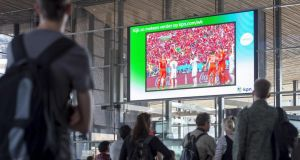 Travellers watch the World Cup on a giant screen in the main hall of the central railway station in Rotterdam, Netherlands. How big a screen can you fit into your living room? Photograph: EPA/Lex van Lieshout