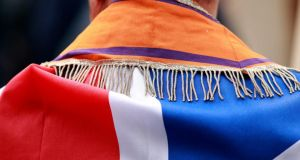 A member of the Orange Order wearing a sash and draped in the union flag marches in Belfast. Figures suggest  the order is a weak and declining organisation. Photograph: Reuters