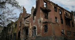 Buildings damaged by a recent shelling are seen in the eastern Ukrainian village of Semenovka yesterday. Photograph: Reuters/Gleb Garanich