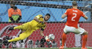 Goalkeeper Sergio Romero of Argentina saves the penalty of Dutch defender Ron Vlaar. Photograph: Marcelo Sayao / EPA