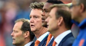 Dutch coach Louis van Gaal  (second left) looks on during the the semi-final against Argentina at Arena de Sao Paulo.  Photograph: Matthias Hangst/Getty Images