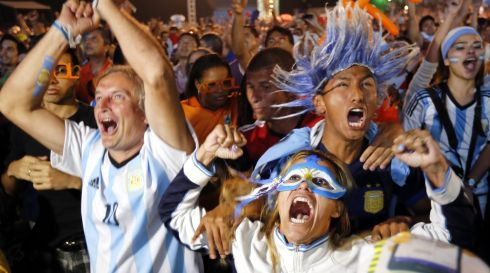 Pure bedlam: Fans of Argentina go mad at the close of the World Cup 2014 semi-final between their victorious side and the Netherlands at the FIFA Fan Fest in Copacabana, Rio de Janeiro, Brazil. Photograph: Abedin Taherkenareh/EPA